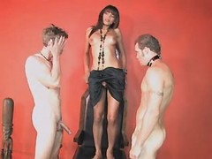 Godlike tranny sucks two slave guys